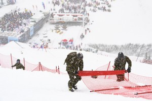 Volunteers take down nets of the men's downhill course of the FIS Alpine Ski World Cup at the Lauberhorn, in Wengen, Switzerland, on Saturday, Jan. 14, 2017. The race had to be cancelled due to heavy snowfall.