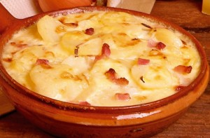 Tartiflette - a mouthwatering melange of gooey cheese, salty bacon, starchy potatoes and caramelised onions